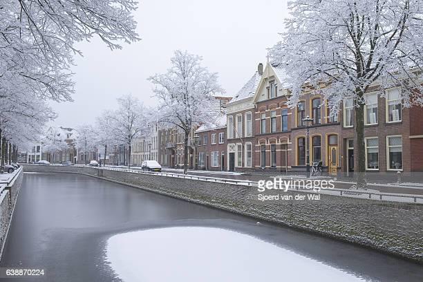 """kampen burgel canal surrounded by frozen trees in winter - """"sjoerd van der wal"""" ストックフォトと画像"""