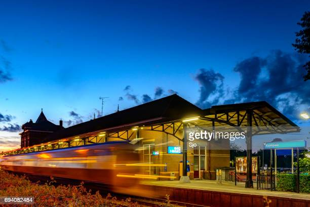 Kampen train station with train departing at night
