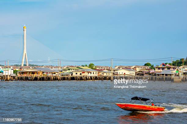 kampong ayer, water village, in bandar seri begawan, brunei. - bandar seri begawan stock photos and pictures