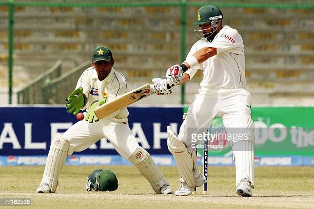 Kamran Akmal and Jacques Kallis during day four of the first test match series between Pakistan and South Africa held at the National Stadium on...