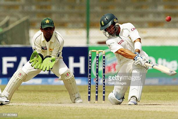 Kamran Akmal and Mark Boucher during day four of the first test match series between Pakistan and South Africa held at the National Stadium on...