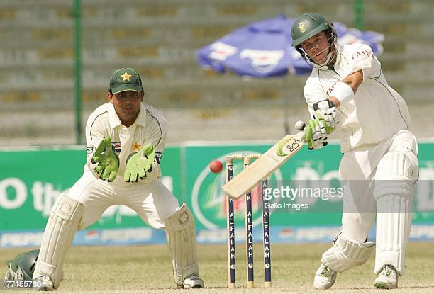Kamran Akmal of Pakistan and AB de Villiers of South Africa in action during day two of the first test match between Pakistan and South Africa at the...