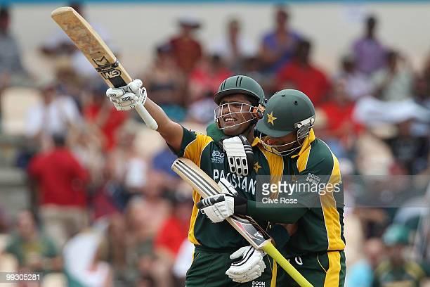 Kamran Akmal of Pakistan celebrates his half century with Salman Butt during the ICC World Twenty20 semi final between Australia and Pakistan at the...