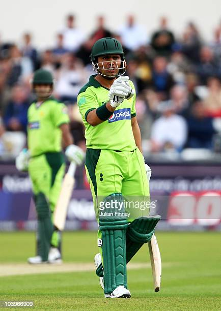 Kamran Akmal of Pakistan exchanges words with Jonathan Trott of England during the 1st NatWest One Day International between England and Pakistan at...