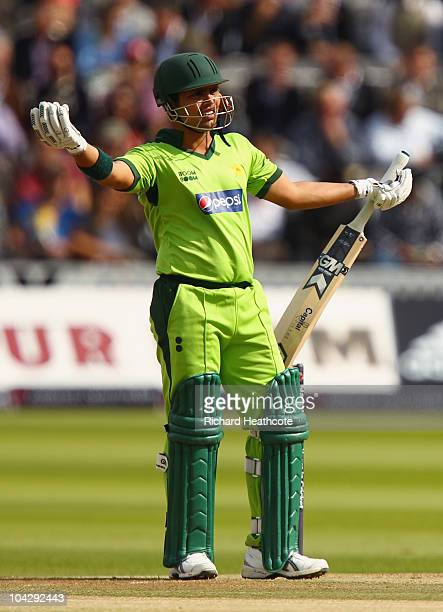 Kamran Akmal of Pakistan gestures after a team mate walked behind the bowlers arm during the 4th NatWest One Day International between England and...