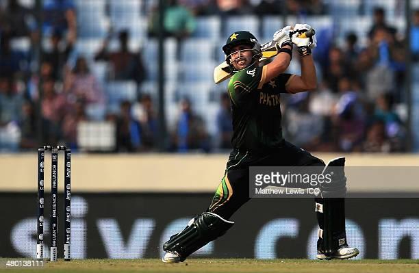 Kamran Akmal of Pakistan hits the bal ltowards the boundary during the ICC World Twenty20 Bangladesh 2014 match between Pakistan and Australia at...