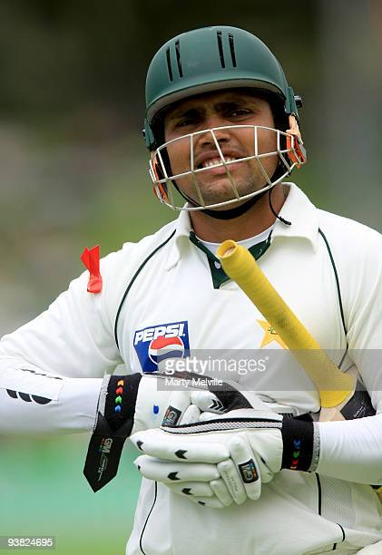 Kamran Akmal of Pakistan walks from the field after being caught out by Daniel Vettori captain of the Blackcaps during day two of the Second Test...
