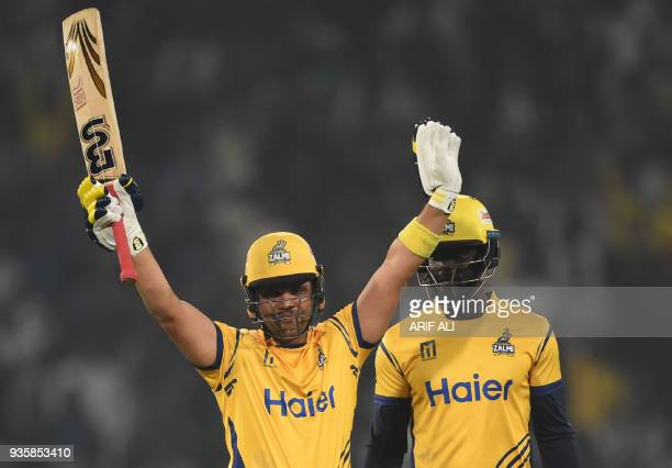 Kamran Akmal of Peshawar Zalmi celebrates after he scored a half century against Karachi King next to his teammate Andre Fletcher during the Twenty20...