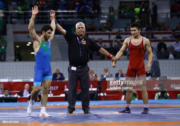 Kamran Mammadov of Azerbaijan celebrates his victory agains Zhanat Kyilybaev of Kyrgyzstan in the Men's Wrestling 66kg Greco Roman final match during...
