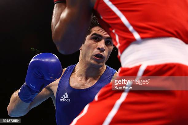 Kamran Shakhsuvarly of Azerbaijan fights against Arlen Lopez of Cuba during a Men's Middle Semifinal bout on Day 13 of the 2016 Rio Olympic Games at...