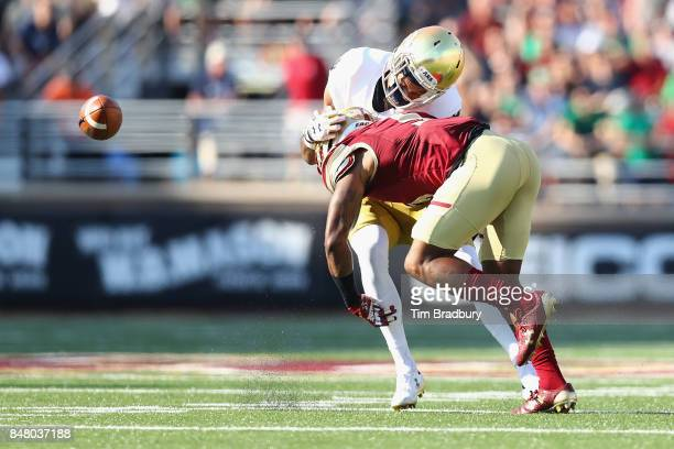 Kamrin Moore of the Boston College Eagles hits Equanimeous St. Brown of the Notre Dame Fighting Irish to force an incomplete pass during the first...