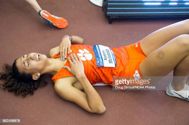Kamryn McIntosh of Clemson University collapses at the end of her leg of the Women's Distance Medley during the Division I Men's and Women's Indoor...