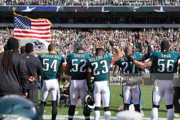 Kamu GrugierHill Najee Goode Rodney McLeod Malcolm Jenkins and Chris Long of the Philadelphia Eagles stand for the national anthem against the...