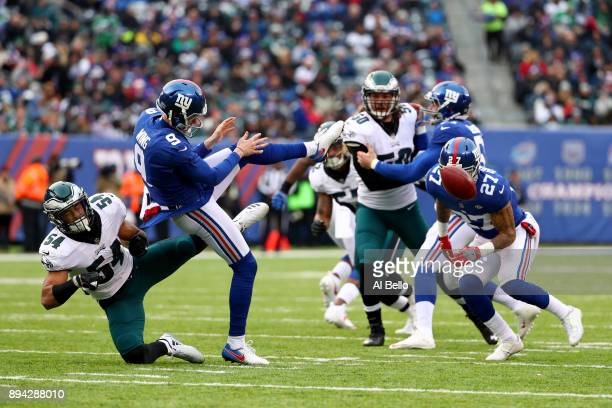 Kamu GrugierHill of the Philadelphia Eagles blocks a punt hicked by Brad Wing of the New York Giants during the second quarter in the game at MetLife...