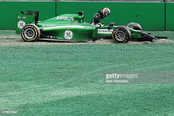 Kamui Kobayashi of Japan and Caterham and Felipe Massa of Brazil and Williams come together and spin out into the gravel at turn one at the start of...