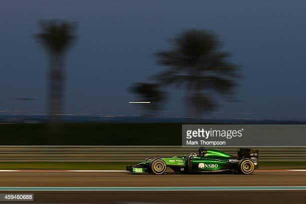 Kamui Kobayashi of Japan and Caterham drives during the Abu Dhabi Formula One Grand Prix at Yas Marina Circuit on November 23, 2014 in Abu Dhabi,...