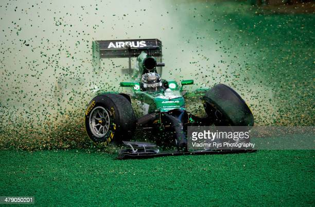 Kamui Kobayashi of Japan and Caterham gets off the track after crashing into Felipe Massa of Brazil and Williams during the Australian Formula One...