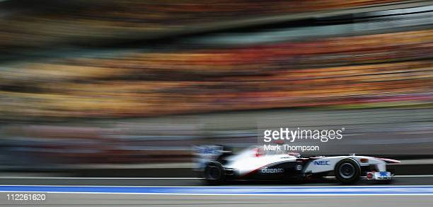 Kamui Kobayashi of Japan and Sauber F1 drives during qualifying for the Chinese Formula One Grand Prix at the Shanghai International Circuit on April...