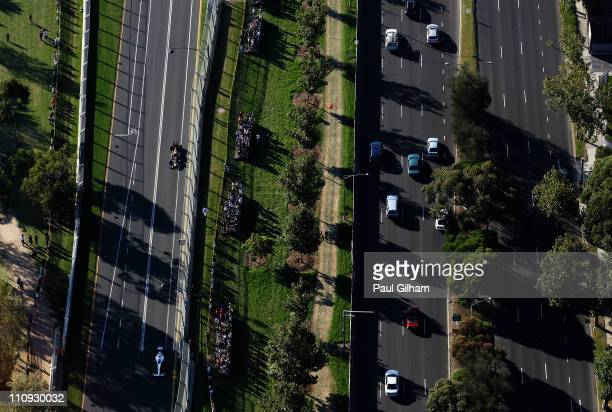 Kamui Kobayashi of Japan and Sauber F1 leads from Mark Webber of Australia and Red Bull Racing during the Australian Formula One Grand Prix at the...