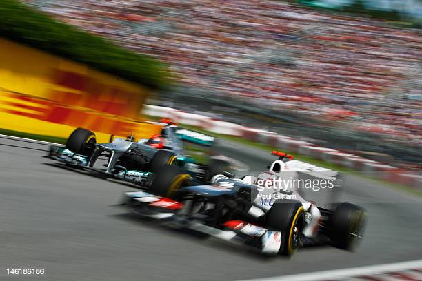 Kamui Kobayashi of Japan and Sauber F1 leads from Michael Schumacher of Germany and Mercedes GP during the Canadian Formula One Grand Prix at the...