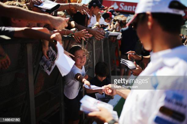 Kamui Kobayashi of Japan and Sauber F1 signs autographs at the drivers autograph session during previews to the European Grand Prix at the Valencia...
