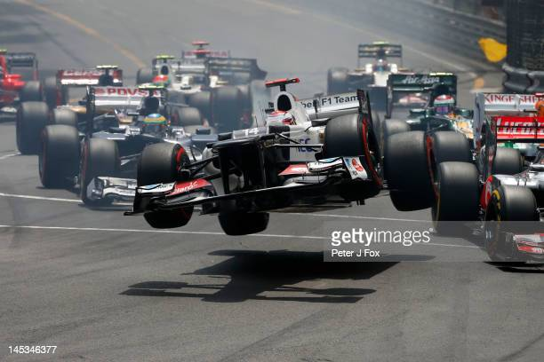 Kamui Kobayashi of Japan and Sauber flies through the air after crashing during the start of the Monaco Formula One Grand Prix at the Circuit de...