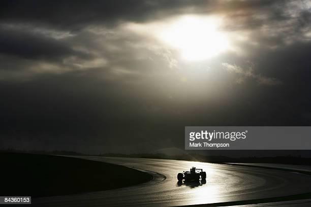 Kamui Kobayashi of Japan and Toyota test drives the new Toyota TF109 during Formula One winter testing at the Autodromo Internacional do Algarve on...