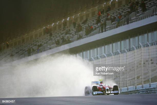 Kamui Kobayashi of Japan and Toyota test drives the new Toyota TF109 during Formula One winter testing at the Autodromo Internacional do Algarve on...