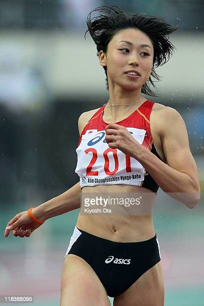 Kana Ichikawa of Japan competes in the Women's 100m Round 1 heats during the day one of the 19th Asian Athletics Championships at Kobe Universiade...
