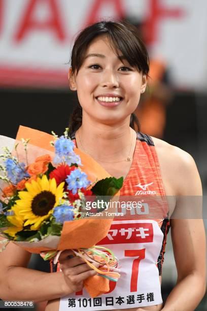 Kana Ichikawa of Japan smiles after winning in the Women 100m final during the 101st Japan National Championships at Yanmar Stadium Nagai on June 24...