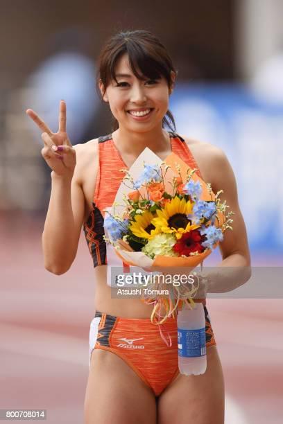 Kana Ichikawa of Japan smiles after winning in the Women 200m final during the 101st Japan National Championships at Yanmar Stadium Nagai on June 25...