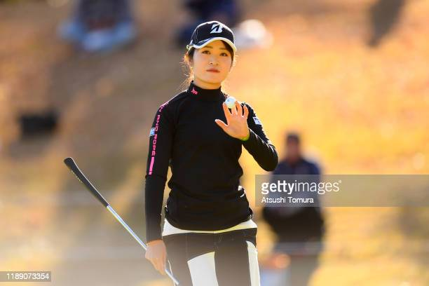 Kana Mikashima of Japan acknowledges after holing out on the 9th green during the first round of the Daio Paper Elleair Ladies at Elleair Golf Club...