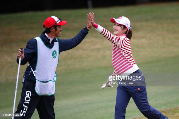 Kana Mikashima of Japan celebrates the eagle with the caddie of HeeKyung Bae of South Korea on the 11th hole during the first round of the LPGA Tour...