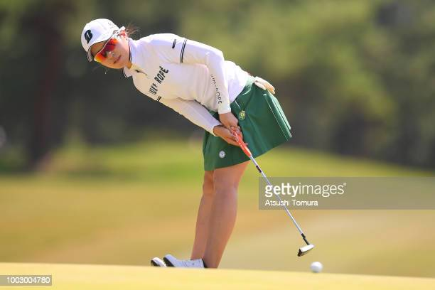 Kana Mikashima of Japan putts on the 17th hole during the second round of the Century 21 Ladies Golf Tournament at the Seta Golf Course West Course...