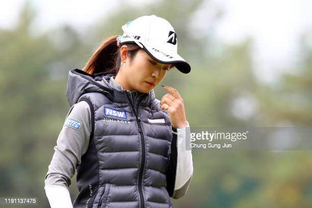 Kana Mikashima of Japan reacts after a putt on the 1st green during the final round of the LPGA Tour Championship Ricoh Cup at Miyazaki Country Club...