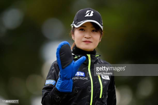 Kana Mikashima of Japan reacts after her tee shot on the 1st hole during the final round of the TOTO Japan Classic at Seta Golf Course North Course...