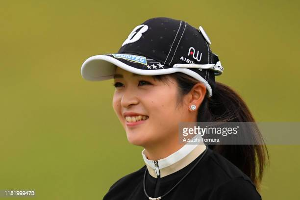 Kana Mikashima of Japan smiles after her second shot on the 14th hole during the second round of Fujitsu Ladies at Tokyu Seven Hundred Club on...