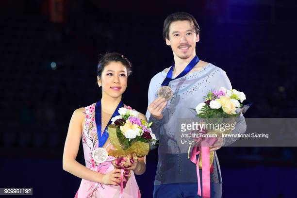 Kana Muramoto and Chris Reed of Japan pose with their bronze medals during day two of the Four Continents Figure Skating Championships at Taipei...