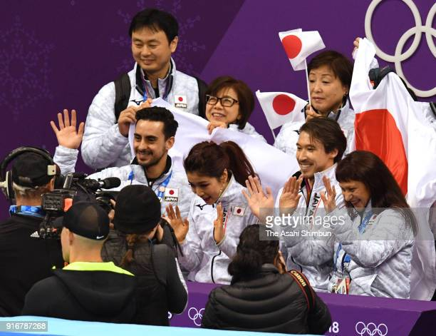 Kana Muramoto and Chris Reed of Japan react after competing in the Figure Skating Team Event Ice Dance Short Dance at the kiss and cry on day two of...