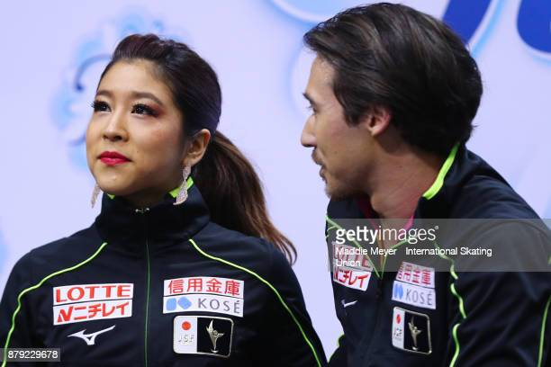 Kana Muramoto and Chris Reed of Japan wait for their score in the Ice Dance short program on Day 2 of the ISU Grand Prix of Figure Skating at Herb...