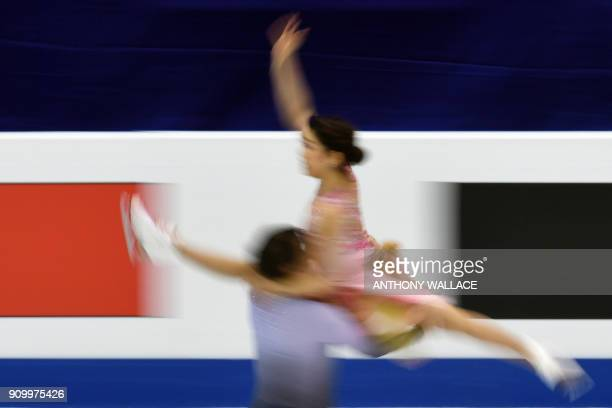 Kana Muramoto and Chris Reed perform during the ice dance free dance program at the ISU Four Continents Figure Skating Championships in Taipei on...