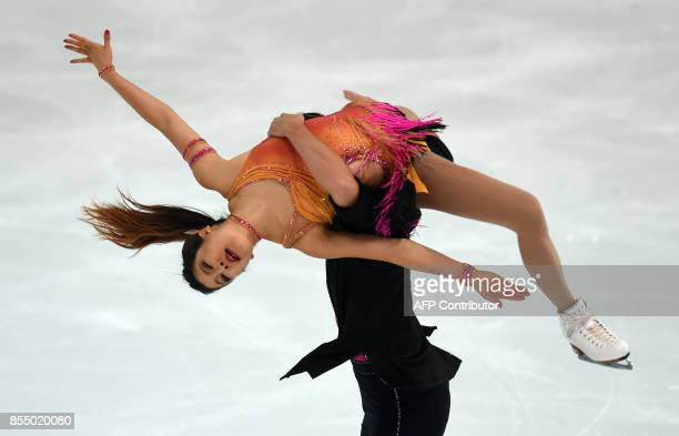 Kana Muramoto and her partner Chris Reed of Japan perform during their ice dance short program of the 49th Nebelhorn trophy figure skating...