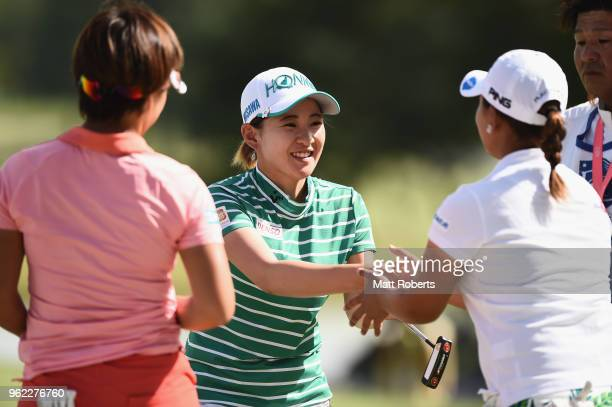Kana Nagai of Japan and Ai Suzuki of Japan shake hands on the 18th green during the first round of the Resorttust Ladies at Kansai Golf Club on May...