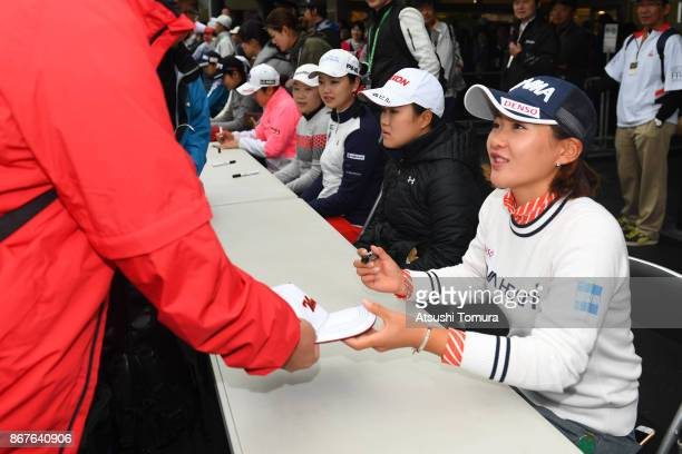 Kana Nagai of Japan attends autograph session after the final day has cancelled because of rain storm during the final round of the Higuchi Hisako...
