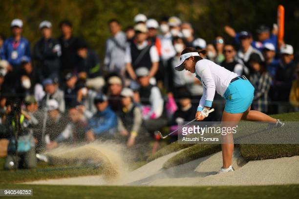 Kana Nagai of Japan hits from a bunker on the 16th hole during the final round of the Yamaha Ladies Open Katsuragi at the Katsuragi Golf Club on...