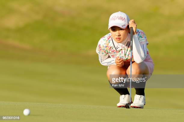 Kana Nagai of Japan lines up for her putt on the 18th green during the second round of the CyberAgent Ladies Golf Tournament at Grand fields Country...