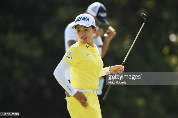 Kana Nagai of Japan reacts after her putt on the 18th green during the first round of the Hoken No Madoguchi Ladies at the Fukuoka Country Club on...