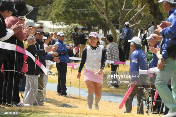 Kana Nagai of Japan walks to the 1st tee ground during the second round of the Yamaha Ladies Open Katsuragi at the Katsuragi Golf Club on March 30...
