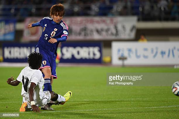 Kana Osafune of Japan scores Japan's 4th goal under the challenge from Portia Boakye of Ghana during the women's international friendly match between...