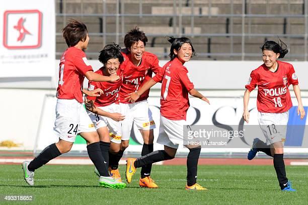 Kana Osafune of Urawa Reds Ladies celebrates scoring her team's first goal with her team mates during the Nadeshiko League match between Urawa Red...